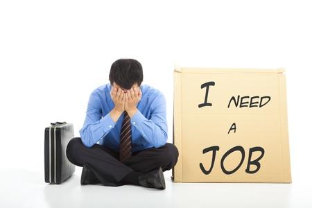 looking for a job: Depressed businessman looking for a job Stock Photo