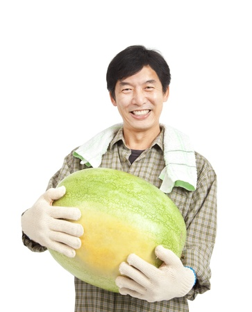 asian produce: happy middle aged  asian farmer holding big watermelon