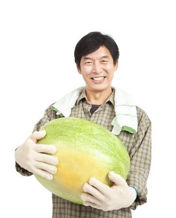 old farmer: happy middle aged  asian farmer holding big watermelon