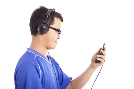 young man holding smart phone and listen music photo