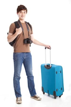 na całej długości młodego podróżnika z walizką