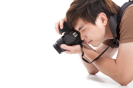 eye traveller: young man with photo camera