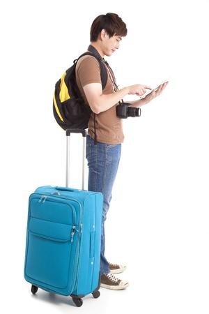 viajero: longitud total de joven viajero con Tablet PC Foto de archivo