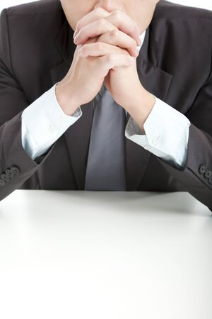 businessman in thinking  with hand on the office desk photo