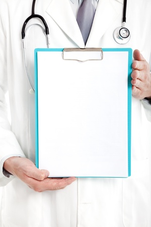 happy doctor: Doctor holding blank clipboard  Stock Photo