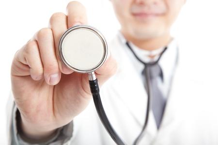 smiling Doctor holding stethoscope Stock Photo - 14099253