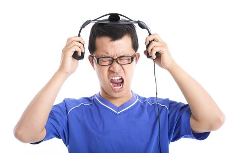 expressing: Young man expressing loud sound  Stock Photo
