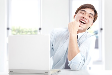 happy businessman working with computer in the office photo