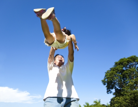 happy father and daughter with blue sky background photo