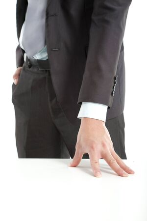 hand of businessman put on the table photo