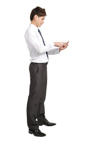 Full length of businessman with smart phone photo