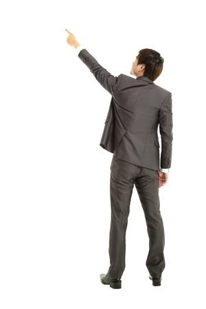 dedo se�alando: vista trasera de negocios que apunta el dedo Foto de archivo