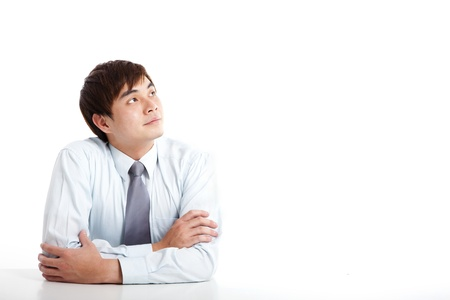 asian businessman: asian young businessman looking up