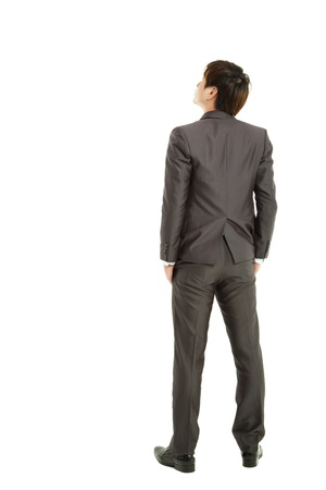 zicht naar achteren zakenman hand in het pakket en het opzoeken van Stockfoto