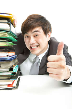 successful businessman with thumbs up in the office Stock Photo - 14234967