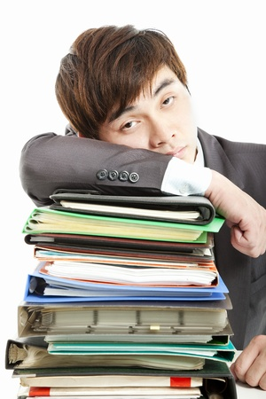 tired Businessman with  paperwork  photo
