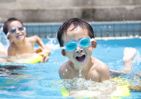 pool fun: asian boy in swimming pool