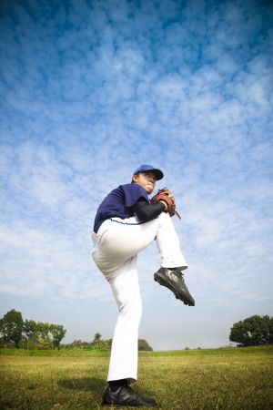 baseball caps:  baseball pitcher ready for throwing the ball Stock Photo