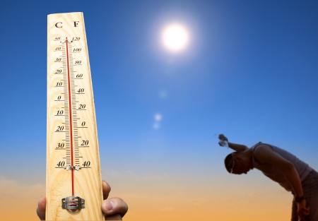 sweat: man throwing water over his head for cooling under heat and summer sky