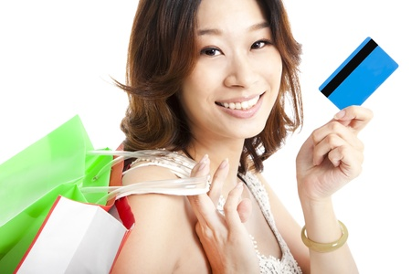happy  woman with shopping bag and credit card photo