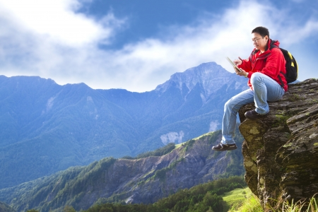 stone tablet: man with tablet pc on the mountain