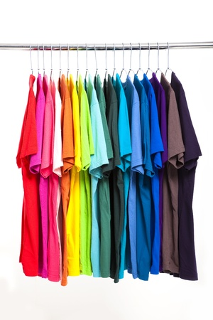 clothing rack: colorful t-shirt with hangers isolated on white Stock Photo