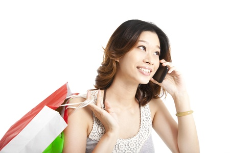 happy  woman holding shopping bag and talking on the phone photo