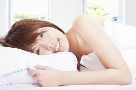 head down: beautiful girl sleeps in the bedroom