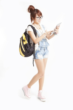 full length of happy teenage girl with tablet pc computer photo