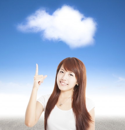 smiling young woman pointing to the cloud photo