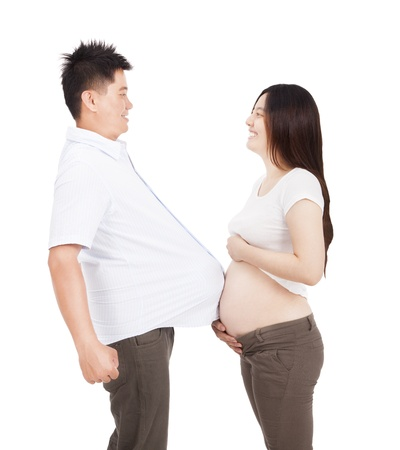 pregnant woman and man with football under shirt photo