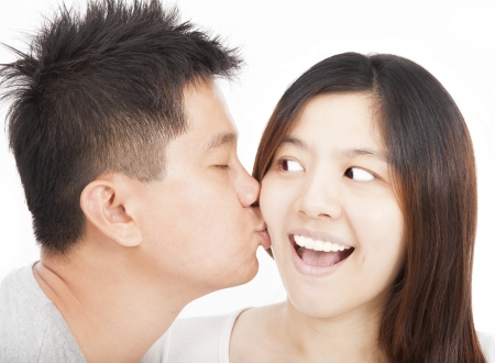 asian young couple kissing photo