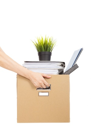 unemployed dismissed: lose job concept hand holding the box of laid off employee Stock Photo