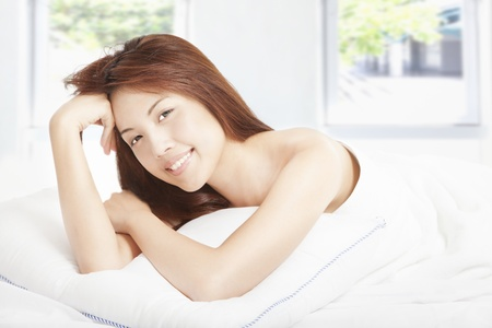 beautiful young woman  in the bedroom Stock Photo - 14758112