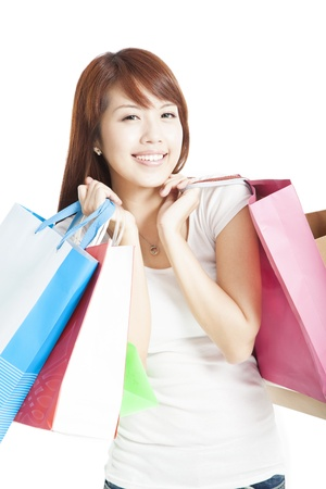 happy smiling Shopping woman holding shopping bags isolated Stock Photo - 14795059