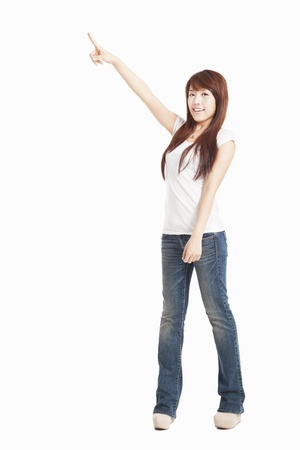 asian Woman pointing to the side standing in full length Stock Photo - 14795058