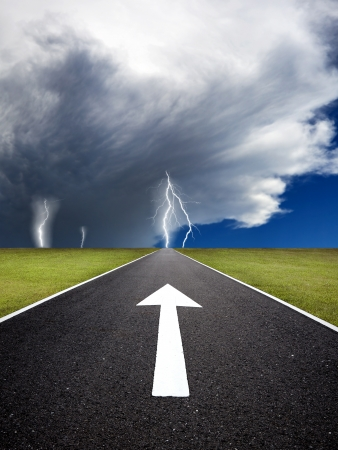 The road to the storm with thunder on the field Stock Photo - 14824012