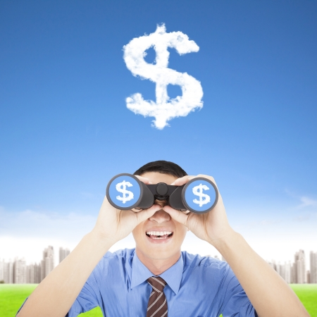 looking for work: happy businessman holding binoculars and watching the money cloud Stock Photo