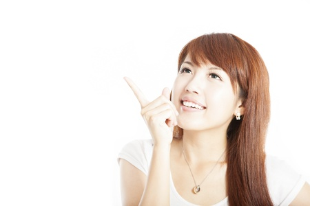 Close up  of  happy young business woman pointing at something photo