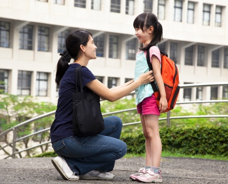 women children: back to school happy asian mother with daughter in school Stock Photo