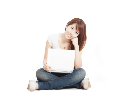 Smiling young woman with a laptop and isolated on white photo