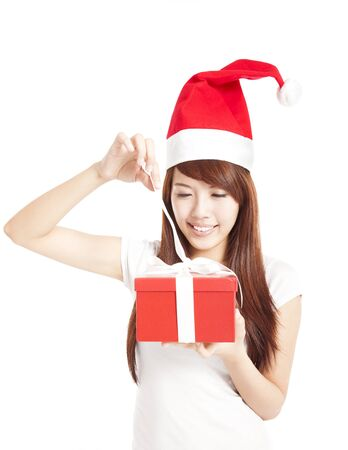 young woman trying to open christmas gift box photo