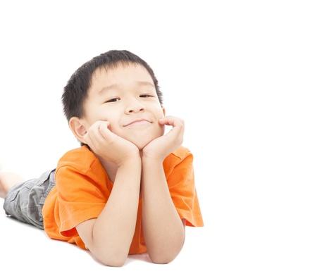 asian boy: asian boy lying on floor isolated on white Stock Photo