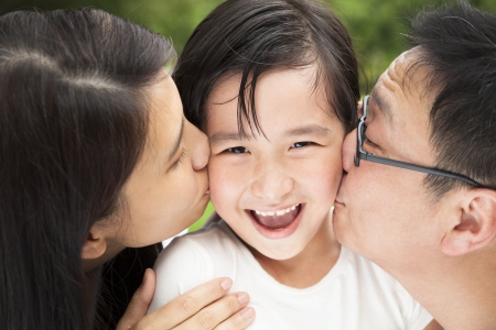 young asian girl: happy asian family in kissing