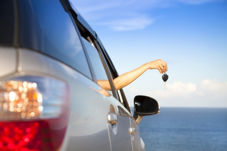 rent car: hand of woman holding car key Stock Photo