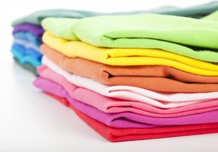 ropa casual: Pila de ropa colorida Foto de archivo
