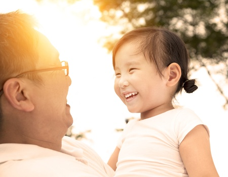 happy asian family: happy little girl with father Stock Photo