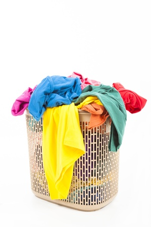 messy clothes: Colorful clothes in a laundry basket Stock Photo
