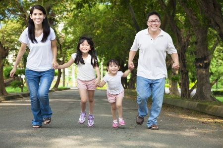 young asian girl: happy asian family walking on the road Stock Photo
