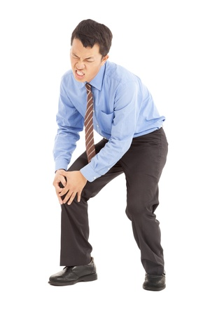 knee joint: businessman with knee pain Stock Photo